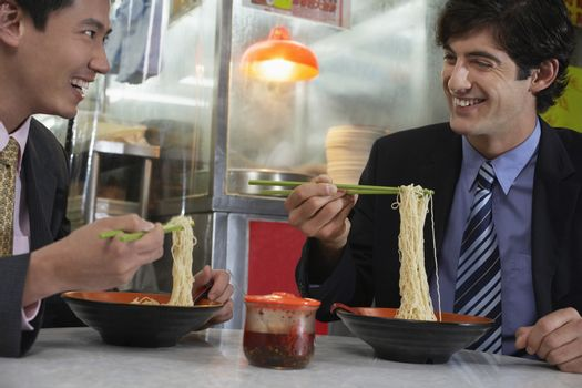 Two business men having lunch in Chinese restaurant