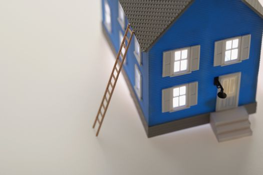 Model house with ladder