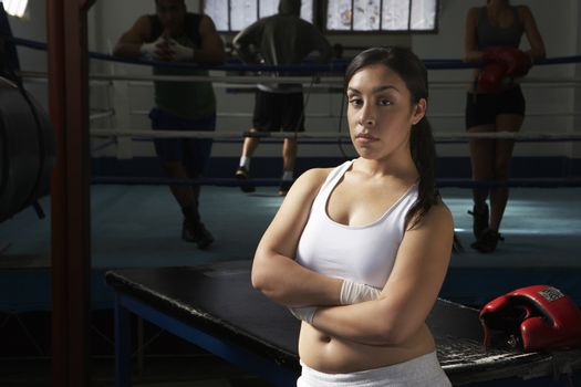 Portrait of woman by boxing ring