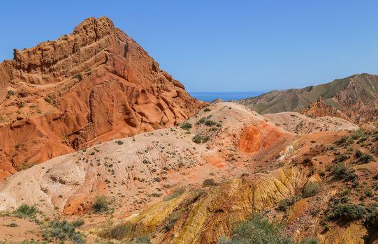 Red sandstone rock formations Seven bulls and Broken heart, Jeti Oguz canyon in Kyrgyzstan, Issyk-Kul region, Central Asia