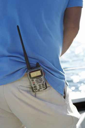 Communication device on man's waist mid section