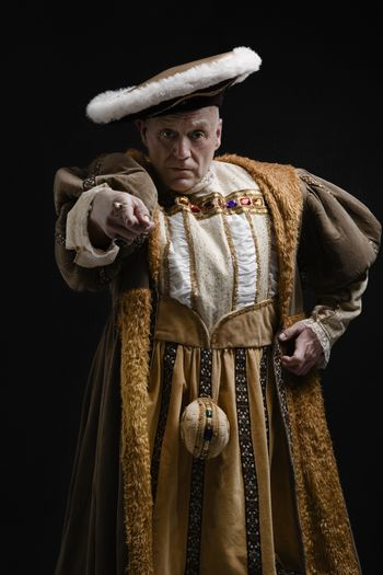 Portrait of King Henry VIII in historical costume pointing