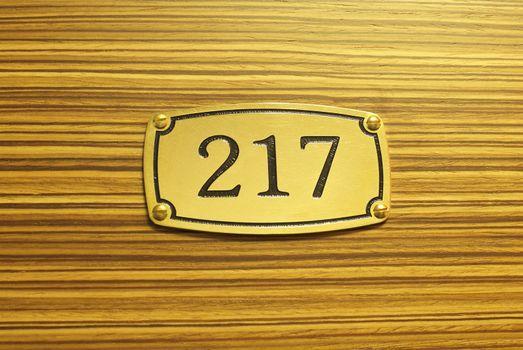 Number plate on wood grain