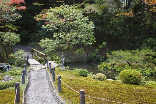 Japan Kyoto Tenju-an Temple garden with footpath and bridge