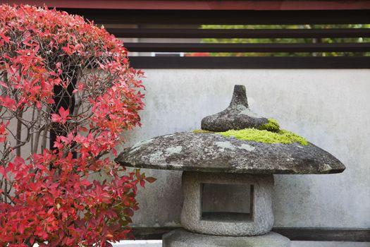 Japan Takayama Stone Lantern and bush in Autumn colors