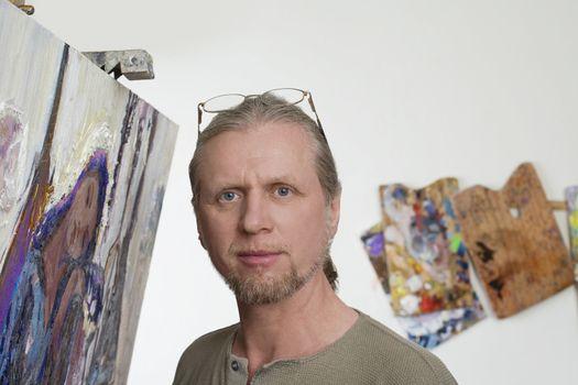 Portrait of painter in studio