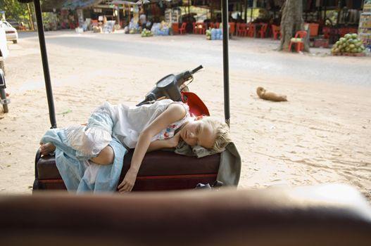 Little Girl Sleeping on Seat of Rickshaw