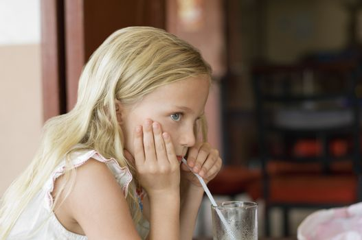 Little Girl Drinking From Straw