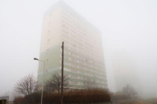 Block of flats hidden behind fog