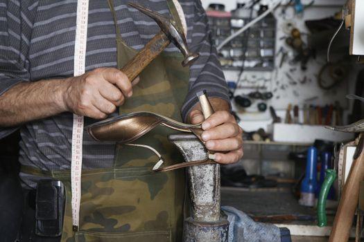Shoemaker Repairing High Heel Shoe