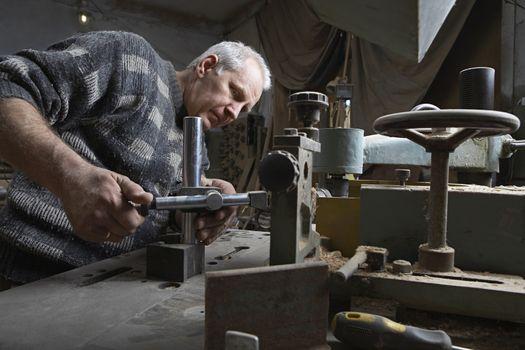 Portrait of Carpenter Working in Workshop