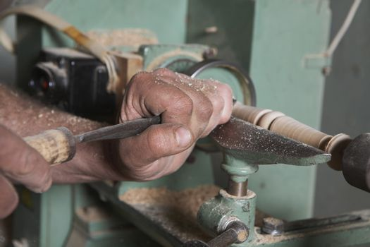 Carpenter Shaping Wood on a Lathe