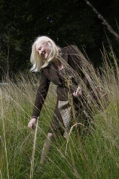 Photo of mature woman walking meadow