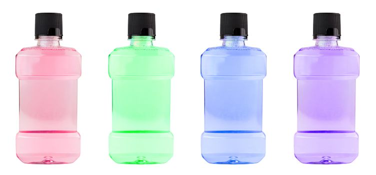 A set of colored plastic bottles of water mouthwash isolated on white background.