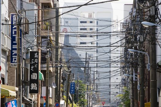 Electrical Lines Criss-Crossing Above City Street