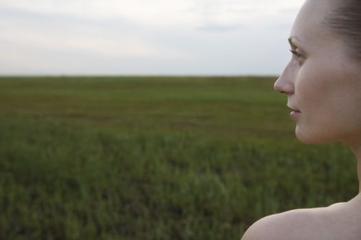 Serene young woman in meadow