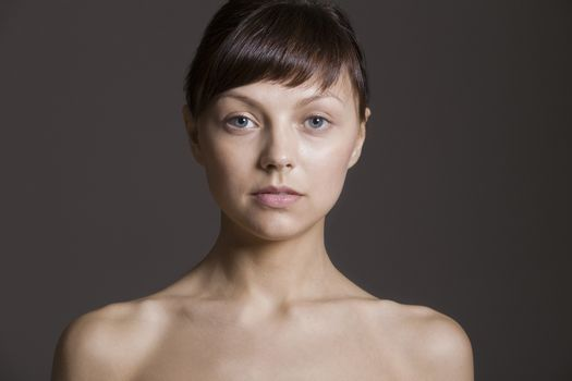 Portrait of young naked woman in studio