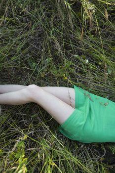 Woman Lying in Tall Grass