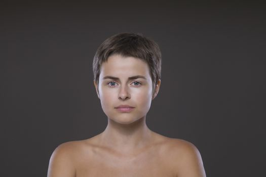 Portrait of a young woman naked in studio