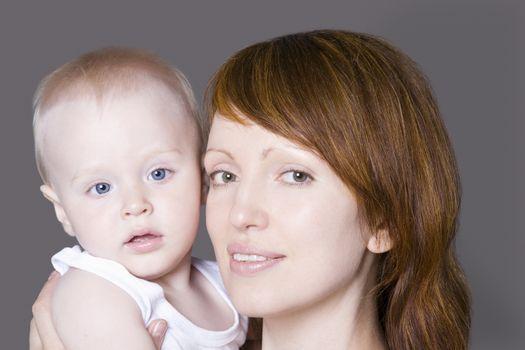 Portrait of mother with baby boy (1-2) studio shot
