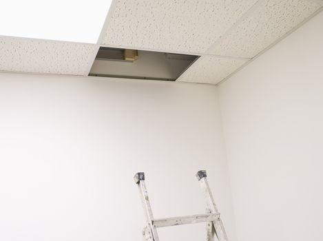 Ladder in Below Open Ceiling Panel in Empty Office