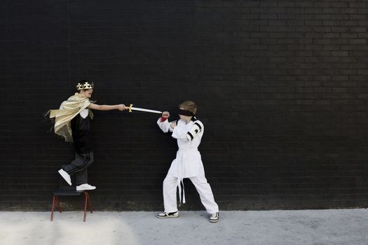 Portrait of little boys playing Accolade