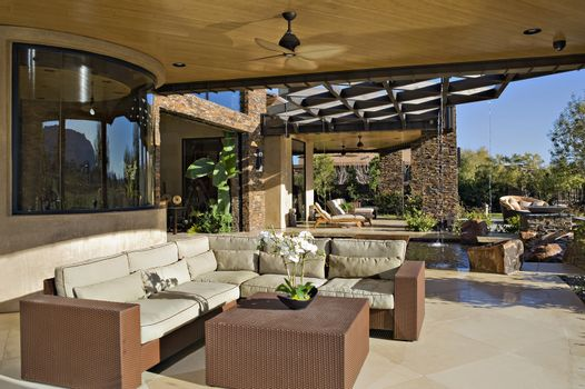 Seating furniture in luxurious patio of manor house