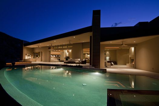 Swimming pool in front of luxury residential house