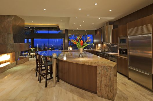 Contemporary kitchen of manor house under lights