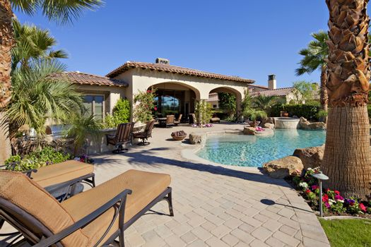 Outdoors seating furniture near swimming pool in luxury villa