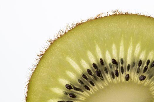 Part of a cut kiwi fruit in backlight foto shot
