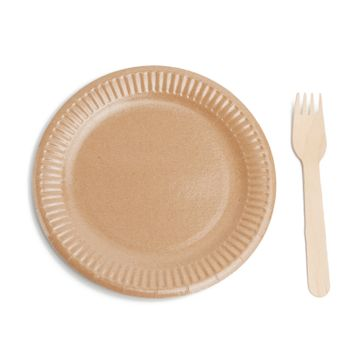 wooden fork and empty round brown disposable plate made from rec