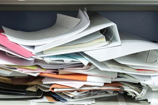 Messy file document and Office Supplies in filing cabinets at work office