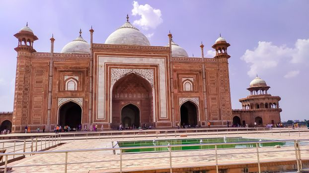 Grand imperial sandstone Persian style domed mausoleum Humayun Tomb in the landscaped char-bagh garden. A finest example of Mughal architecture and iconic structures. New Delhi India May 2019