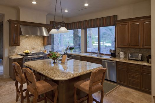 Contemporary kitchen counter with chair in luxury villa