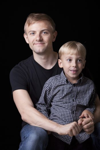 Portrait of man with son in studio