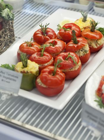 Close-up of stuffed tomatoes in serving dish