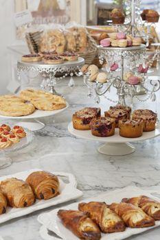 Fresh varieties of bread and sweet food at bakery