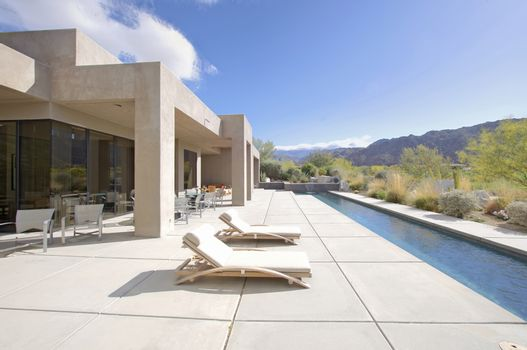 House exterior with lap pool