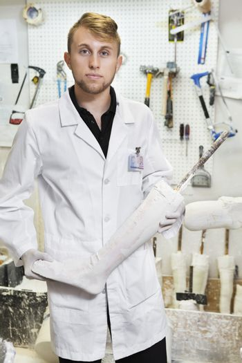 Portrait of a young male technician with prosthetic foot