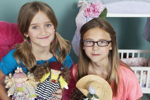 Portrait of Caucasian girls with dolls