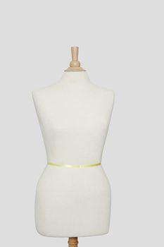 Dressmaker's model against gray background