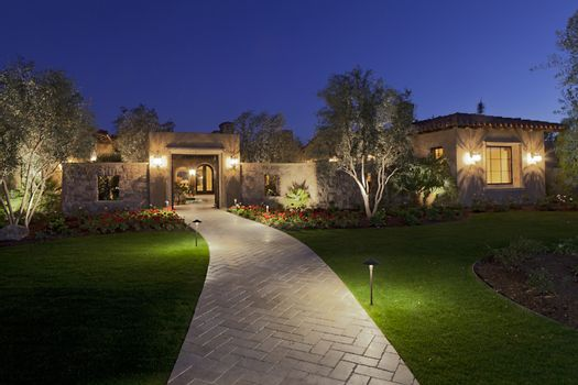 Garden path leading to residential front gate at dusk