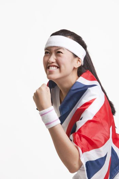 Portrait of asian tennis athlete with british flag