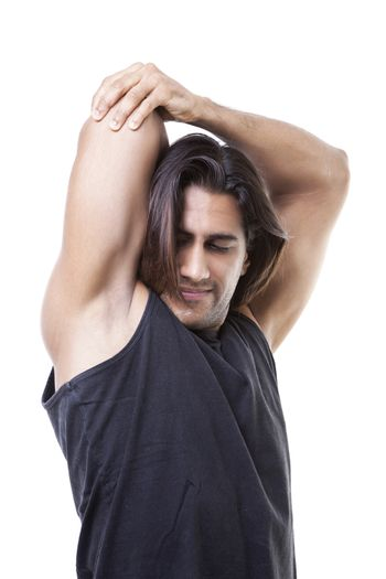 Portrait of masculine guy flexing his muscles