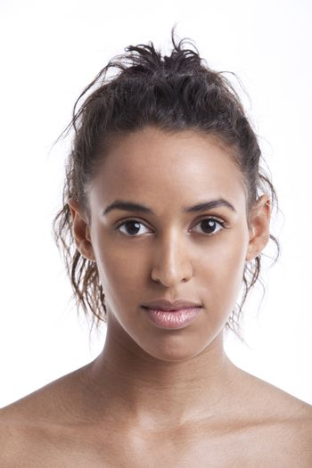 Portrait of young Mixed Race woman against white background