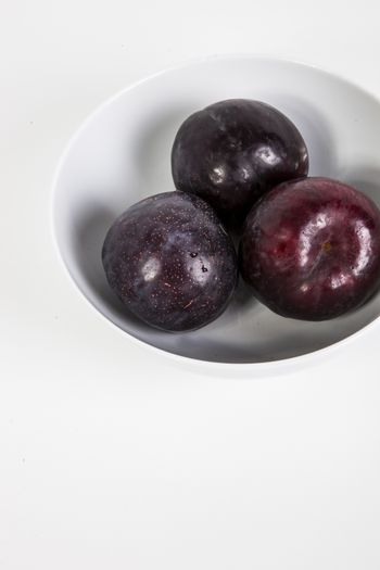 Close-up of plums in bowl