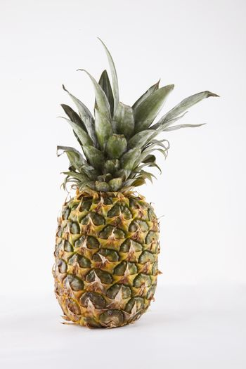 Pineapple over white background