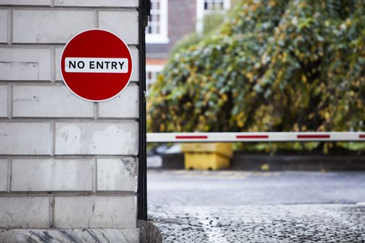 No Entry sign on wall by street
