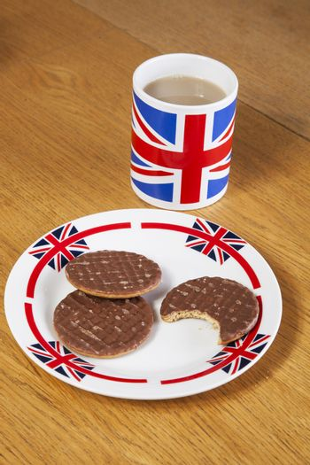 Chocolate biscuits in plate with British coffee mug
